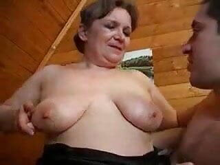 Mature mom and young boy